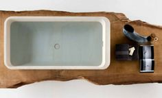 bathtub design looks from above with a bath integrates with the wood really cool design