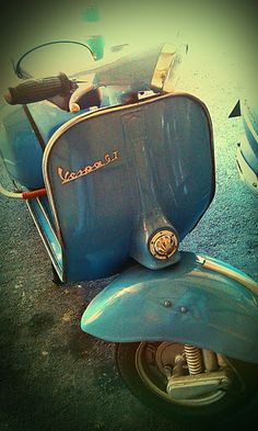 Vespa.....I used to wait for Dad at the end of the street for him to come home from work on his Vespa, and then I'd get a ride home with him :)