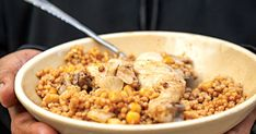 This hearty couscous dish is layered with chickpeas and bathed in a broth fragrant with garlic and lemon, and served with crisp-skinned chicken.