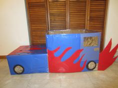 Car made from cardboard box. Fun easy idea for family drive-in movie night.  I used wrapping paper to cover this box.