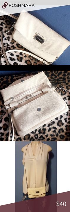 Nine West mini crossbody bag! Cute Nine West mini crossbody bag! Only used it once but still like new. Well taken care of. Cute to wear for a date. Leopard print inside. Reasonable negotiations ✅ bundle with blouse and save! :) Nine West Bags Mini Bags