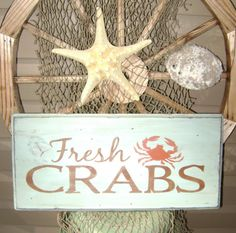 I LOVE the image of a crab and anything to do with Maryland blue crabs...this would be so cute in our kitchen with the crab plates we got on our honeymoon in St. Michaels, MD. I love the fonts and the worn look of this sign.