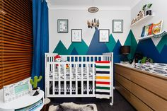 Baby boy's nursery with bright colours mountains painted as a background. The feathers and other forrest related products complement the overall theme. I love that the room is different from your standard boy's room. Bright Colours, Baby Boy Nurseries, Interior Design Services, Perth, Feathers, Nursery, Spaces, Mountains, Holiday Decor