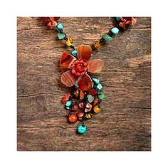 @Overstock - This lavish necklace by Nareerat features a summery floral motif. The necklace features beautiful agate and carnelian gemstones.http://www.overstock.com/Worldstock-Fair-Trade/Agate-and-Carnelian-Summer-Flower-Necklace-Thailand/5074090/product.html?CID=214117 $35.49
