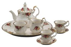 Royal Albert Old Country Roses Le Petite Miniature  The best-selling dinnerware pattern in the world, the old country roses pattern is practically synonymous with the name and a long-standing testament to timeless style and elegant craftsmanship. The le petite 9-piece miniature tea set features 2 teacups, 2 saucers, a teapot with lid, creamer, sugar bowl and a tray; all decorated with the old country roses signature motif of burgundy, pink and yellow roses, accented with lustrous gold…