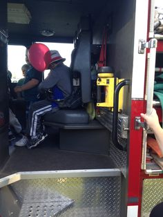 Zachy riding in the back of a Fire Engine.