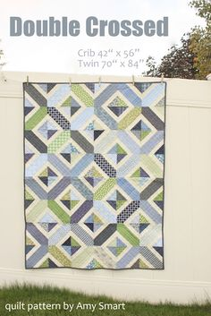 Diary of a Quilter - a quilt blog: Navy and Green Crib Quilt + pattern    Love this geometric look!