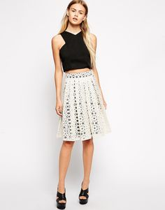 """Skirt by ASOS Collection 100% Nylon Embroidered organza design High-rise waist Pleated finish Side zip fastening Regular fit - true to size Our model wears a UK 8/EU 36/US 4 and is 173 cm/5'8"""" Hand was"""