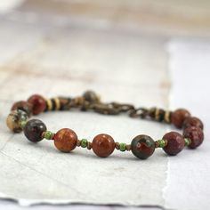 """A very rustic interpretation of """"red and green"""" holiday accessories! Only one of these bold jasper stone bracelets in my shop."""