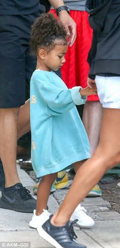 Just like Kim!North looked cute wearing a turquoise Yeezy 'The Life of Pablo' sweater and white sneaker