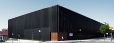 Image 9 of 30 from gallery of Gordailu Building / Astigarraga y Lasarte. Photograph by Jorge Allende Factory Architecture, Architecture Office, Architecture Design, Building Exterior, Building Facade, Black Building, Timber Battens, Retail Facade, Warehouse Design
