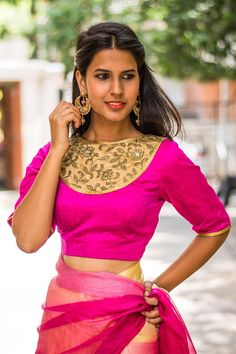 We think a fuchsia blouse is a must have in every blouse wardrobe. And talking about fuchsia blouses…this blouse is one cool number! High on style and detailing with a gold threadwork bib yoke edged with gold lace, having trendy elbow length sleeves. Any contrast saree or a saree having a fuchsia pink border or print will do nicely. A fuchsia pink blouse is truly versatile and can be combined in a myriad ways! #pink #gold #bib #blouse #India #saree #houseofblouse