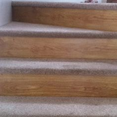 After photo of stairs using carpet remnants on treads & left over wood/laminate on risers Wood Laminate, Laminate Flooring, Diy Wood Projects, Home Projects, Carpet Remnants, Wood Stairs, Basement Stairway, Light Hardwood Floors, Carpet Stairs