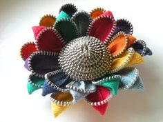 This is a recycled vintage zipper that has been transformed into a unique flower. The flower can be worn either as a hair clip or a pin and will include both options upon purchase. Each flower varies a tad bit in size but typically measure from 2.5 to 3 inches.  If you have any questions please feel free to ask.