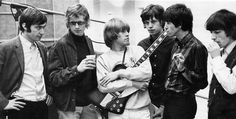 The Stones with Andrew Loog Oldham, producer of Satisfaction, 1965.