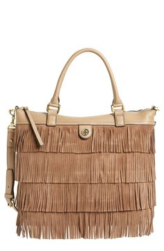 Boho chic -  Adding texture to the fall wardrobe with this Tory Burch fringe leather tote.