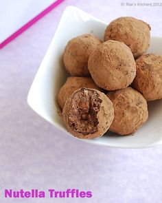 NUTELLA TRUFFLES. would be amazing using crushed-up Oreos in these as well. mmm....