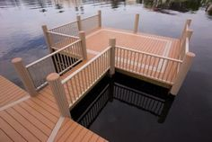 A boat dock with railings in Azek Fawn.