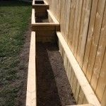 12 DIY Raised Garden Bed Tutorials: Garden beds along fence