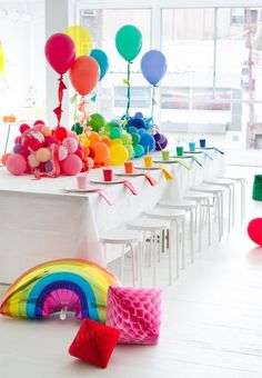 A Rainbow Baby Shower. Great use of balloons to make the centerpiece and large scale party decor.