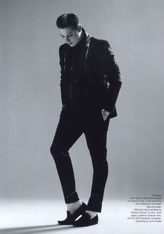 John Newman. Ah, his famous black shoes, white socks. He can pull it off wonderfully though!!!