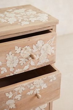 Pearl Inlay Dresser - anthropologie.com. You could create a similar effect with paint and stencils.