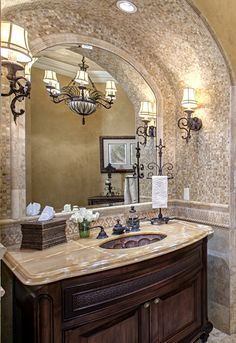 Powder Room ~ would do a different sink, counter top and lights.