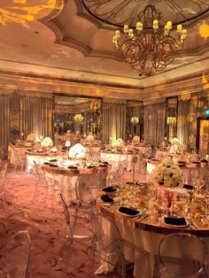 Gorgeous Gold Mirror Tables with clear acrylic Edwardian Ghost Chairs.
