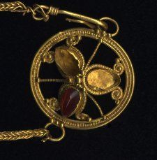 Pendant of Roman-period necklace, said to have been found at the sanctuary of Apollo Hylates, 2nd or 3rd century AD. One of the three gems remains in its cloisonné setting.