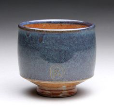 Love this glaze combo teacup with dark blue and orange shino glazes by rmoralespottery