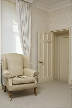 Painted door and woodwork in Farrow & Ball's String #8, ceiling painted in All White, wallpaper is Farrow & Ball's Silvergate BP802