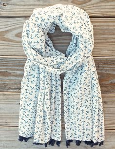 A light- weight ethically made cotton scarf that features a blue anchor print with blue tassels. *100% cotton  *Fair trade & made in India *Designed in New Orleans