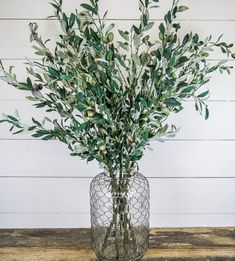 Faux Olive Branches.  CC&Mike had 3 branches that filled a really big vase.  Looked real