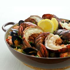 Wow family and friends with this delicious Lobster Paella studded with succulent lobster tails, mussels, salmon, and chorizo. They'll be back for seconds! | Food to gladden the heart at RotiNRice.com