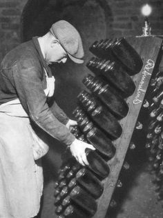 Moving the bottles of Champagne (remuage) on the riddling tables
