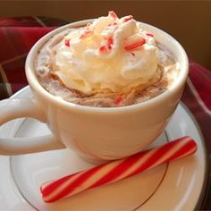 "Candy Cane Cocoa   *4 cups milk       3 (1 ounce) squares semisweet chocolate, chopped       *4 peppermint candy canes, crushed       *1 cup whipped cream       *4 small peppermint candy canes       >>>> Recipe by Verushka  ""The rich flavor of chocolate combines so well with peppermint. This is the perfect drink to sip while trimming the tree."" <<<<"