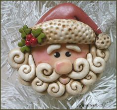 This Santa Claus face ornament measures about 3 1/4 to 3 1/2 tall.  He has been lovingly created in polymer clay by me! I make a bead similar