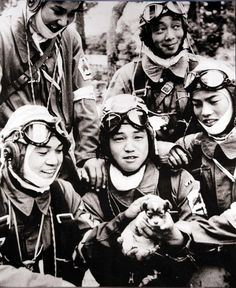 Kamikaze pilots posing with a puppy the day before their suicide missions, 1945