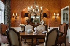 Dining room with burnt orange wallpaper and paisley chairs - McCroskey Interiors - Photo by Chad Jackson