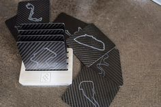 Finally available! Carbon fiber coasters with world famous race track inspired etchings.