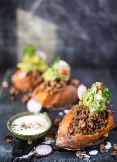 Paleo Taco-Stuffed Sweet Potatoes with Coconut-Cumin Crema  #justeatrealfood #cookprimalgourmet