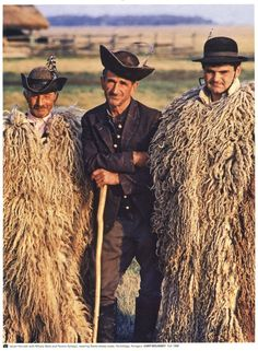 A picture taken of three men in Hungary in Two of the men are wearing traditional Racka sheep coats. Traditional wool garments and utilitarian objects in history have heavily influenced my felt work. Their hats appear to be felt as well. We Are The World, People Around The World, Wooly Bully, Folk Dance, Folk Costume, Costumes, Central Europe, Budapest Hungary, World Cultures