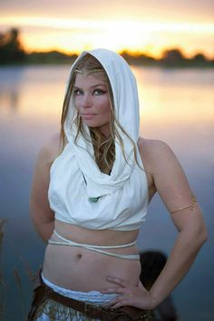 Kayla glowing with the sky in her Ivory cowl hood crop top.