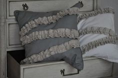gray ruffled pillow cover.