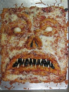 "Puts the ""nom"" in Necronomicon.  lol  I'm seriously making this pizza one day!  If not for Halloween, then for an Evil Dead marathon.  ;)"