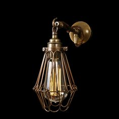 The Edom Industrial Cage Wall Light has designed to fit snugly and effortlessly against a wall, spreading its lighting effect across the surrounding space. This cage wall light is a perfect addition to industrial and steampunk styled rooms.  Playing on the sense of depth and perspective, this industrial wall light brings understated beauty to any space. Inside a steel mesh cage sits a single retro bulb, casting soft ambient glow.   #cage #indoor #light