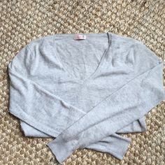 100 % Cashmere sweater super soft ! 100 percent cashmere sweater in light grey color. V neck and incredible may soft !! Just like  J. Crew cashmere but softer ! Tissue weight. Thinner but still okay to wear on its own ! Great used condition. Minor piling as with any cashmere Pink Pineapple Sweaters V-Necks