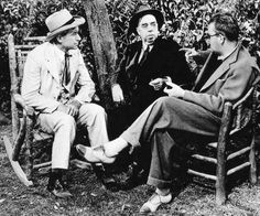 """Will Rogers, the most loved American of the mid 1930s, with writer Irvin Cobb and Ford on the set of """"Judge Priest"""" 1934"""