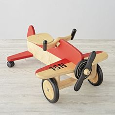 Shop Airplane Ride On Toy.  Fly the friendly floors with this exclusively designed airplane ride-on.  With a sturdy wood construction and nontoxic finish, it's ready and rarin' for takeoff.