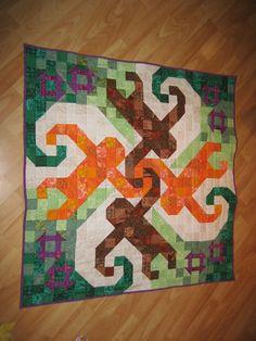 "Orangutan Square Dance Baby Quilt. Designer used allemande right monkey star block. Pieced with stitch and flip technique. 36""x36"""